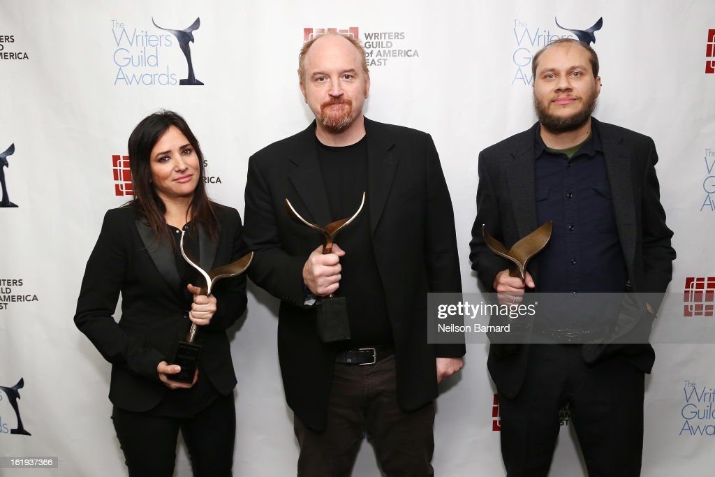 Actress Pamela Adlon, comedian Louis C.K., and writer Vernon Chatman pose backstage at the 65th annual Writers Guild East Coast Awards at B.B. King Blues Club & Grill on February 17, 2013 in New York City.