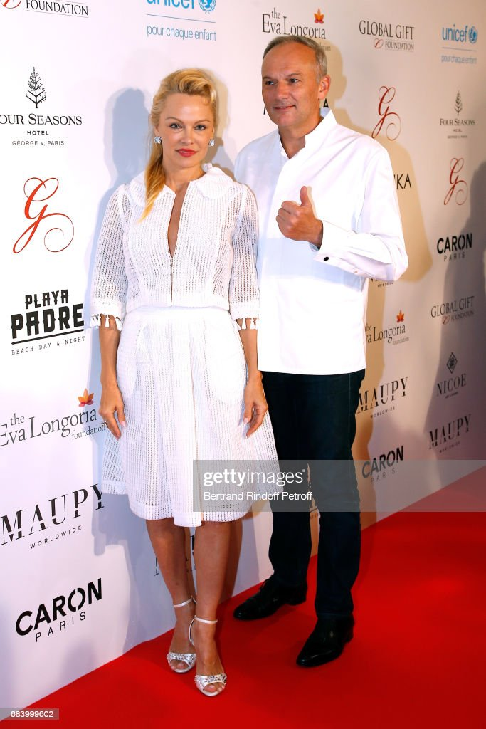 Actress Pamela Anderson and Chef of the George V, Christian Le Squer attend the 'Global Gift, the Eva Foundation' Gala : Photocall at Hotel George V on May 16, 2017 in Paris, France.