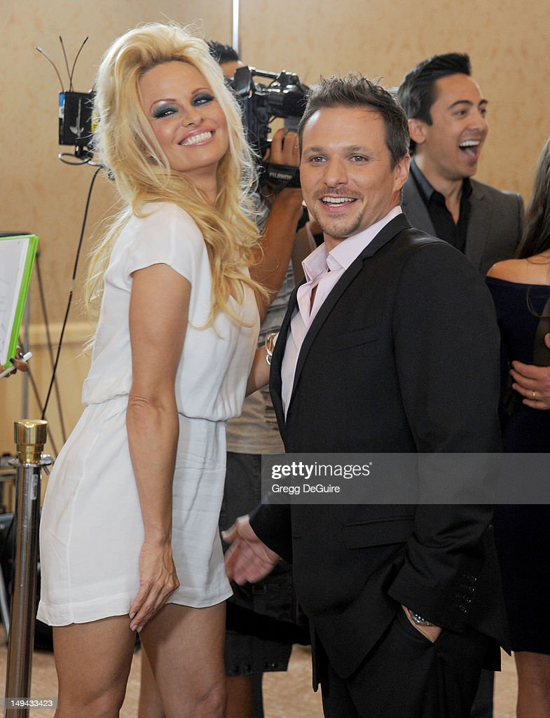 Actress <a gi-track='captionPersonalityLinkClicked' href=/galleries/search?phrase=Pamela+Anderson&family=editorial&specificpeople=171759 ng-click='$event.stopPropagation()'>Pamela Anderson</a> and <a gi-track='captionPersonalityLinkClicked' href=/galleries/search?phrase=Drew+Lachey&family=editorial&specificpeople=550274 ng-click='$event.stopPropagation()'>Drew Lachey</a> arrive at the 2012 Disney ABC Television TCA summer press tour party at The Beverly Hilton Hotel on July 27, 2012 in Beverly Hills, California.