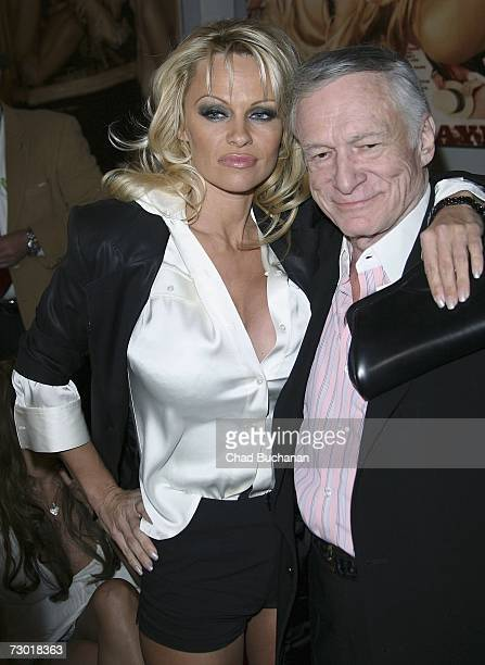 Actress Pamela Anderson and Hugh Hefner attend the Playboy Legacy Collection launch event at Republic on January 16 2007 in Los Angeles California