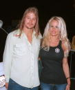 Actress Pamela Anderson and musician Kid Rock pose outside the Hollywood Bowl for the Aerosmith concert on November 3 2002 in Hollywood California