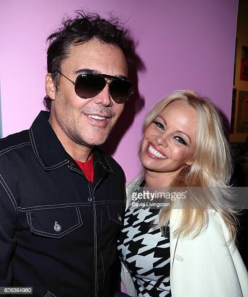Actress Pamela Anderson and photographer David LaChapelle attend the opening reception for David Hockney's 'A Bigger Book' at TASCHEN Gallery on...