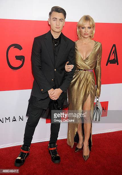 Actress Pamela Anderson and son Brandon Thomas Lee arrive at the Los Angeles premiere of 'The Gunman' at Regal Cinemas LA Live on March 12 2015 in...