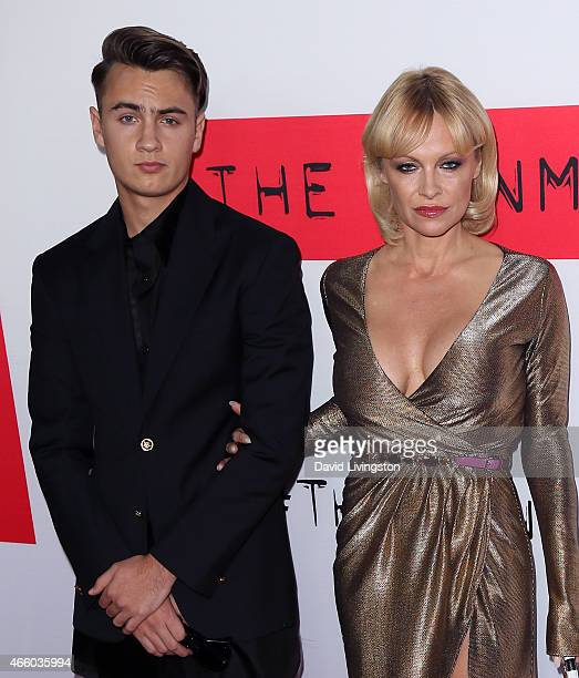 Actress Pamela Anderson and son Brandon Thomas Lee attend the premiere of Open Road Films' 'The Gunman' at Regal Cinemas LA Live on March 12 2015 in...