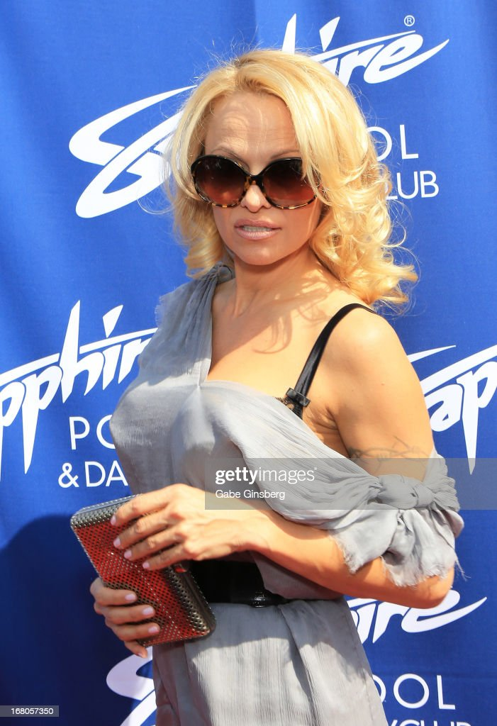 Actress Pamela Anderson arrives at the Sapphire Pool & Day Club grand opening party on May 4, 2013 in Las Vegas, Nevada.