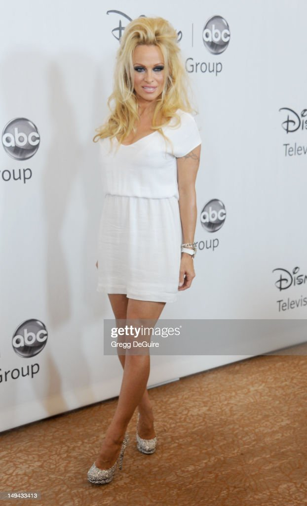 Actress <a gi-track='captionPersonalityLinkClicked' href=/galleries/search?phrase=Pamela+Anderson&family=editorial&specificpeople=171759 ng-click='$event.stopPropagation()'>Pamela Anderson</a> arrives at the 2012 Disney ABC Television TCA summer press tour party at The Beverly Hilton Hotel on July 27, 2012 in Beverly Hills, California.