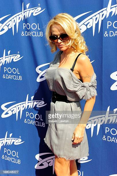 Actress Pamela Anderson arrives at the Sapphire Pool Day Club grand opening party on May 4 2013 in Las Vegas Nevada