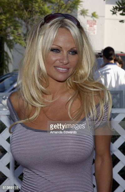 Actress Pamela Anderson arrives at the Standup For Skateparks benefit on October 3 2004 at Pinz Bowling Alley in Studio City California