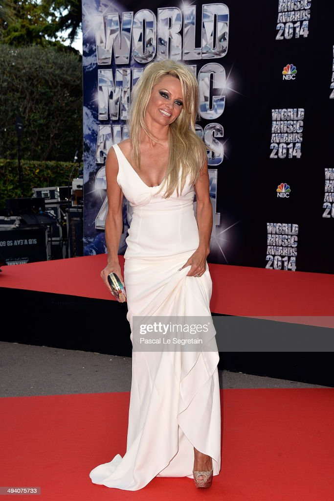 Actress <a gi-track='captionPersonalityLinkClicked' href=/galleries/search?phrase=Pamela+Anderson&family=editorial&specificpeople=171759 ng-click='$event.stopPropagation()'>Pamela Anderson</a> arrives the World Music Awards at Sporting Monte-Carlo on May 27, 2014 in Monte-Carlo, Monaco.