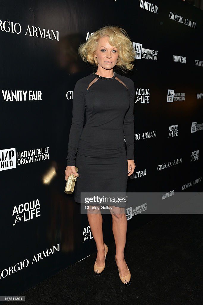 Actress Pamela Anderson attends the Giorgio Armani Paris Photo LA event at Mr. Chow on April 25, 2013 in Beverly Hills, California.