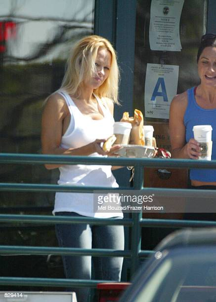 Actress Pamela Anderson buys coffee at Starbuck's February 26 2002 in Malibu CA