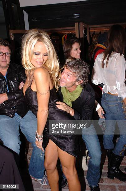Actress Pamela Anderson Dances with Vivi Nevo at the grand opening party of Chrome Hearts clothing and fashion accessories store located in the Forum...