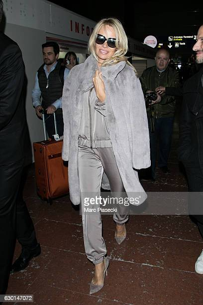 Actress Pamela Anderson is seen at CharlesdeGaulle airport on December 17 2016 in Paris France