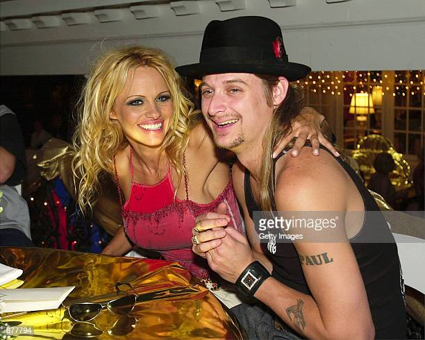 Actress Pamela Anderson left with her escort Kid Rock laugh as they take their seats to enjoy the festivities of the BarnstableBrown Derby Eve Gala...