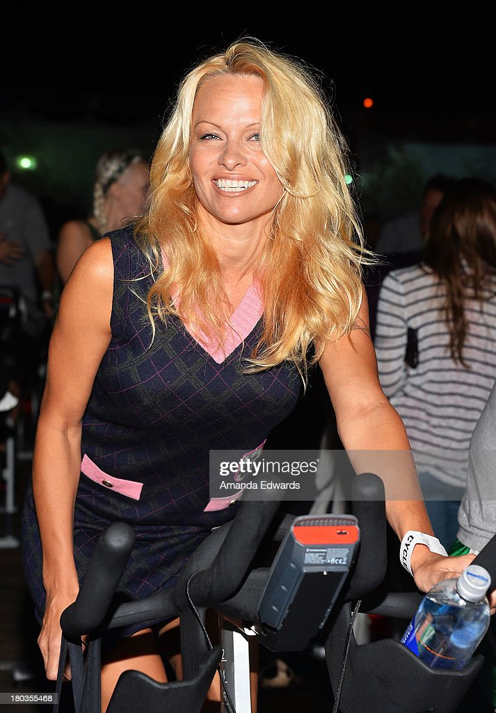 Actress <a gi-track='captionPersonalityLinkClicked' href=/galleries/search?phrase=Pamela+Anderson&family=editorial&specificpeople=171759 ng-click='$event.stopPropagation()'>Pamela Anderson</a> participates in the Cycle For Heroes: A Rock Inspired Ride On Santa Monica Pier at Santa Monica Pier on September 11, 2013 in Santa Monica, California.