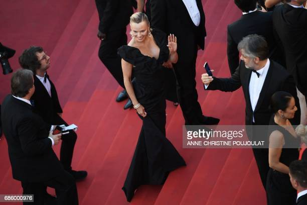 CORRECTION US actress Pamela Anderson poses as she arrives on May 20 2017 for the screening of the film '120 Beats Per Minute ' at the 70th edition...