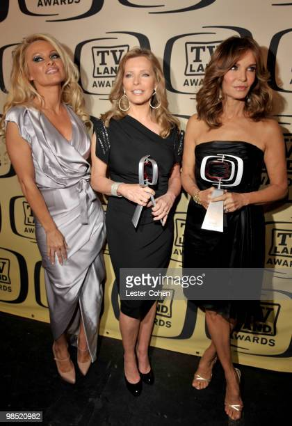 Actress Pamela Anderson poses backstage with Pop Culture award winners actresses Cheryl Ladd and Jaclyn Smith during the 8th Annual TV Land Awards at...