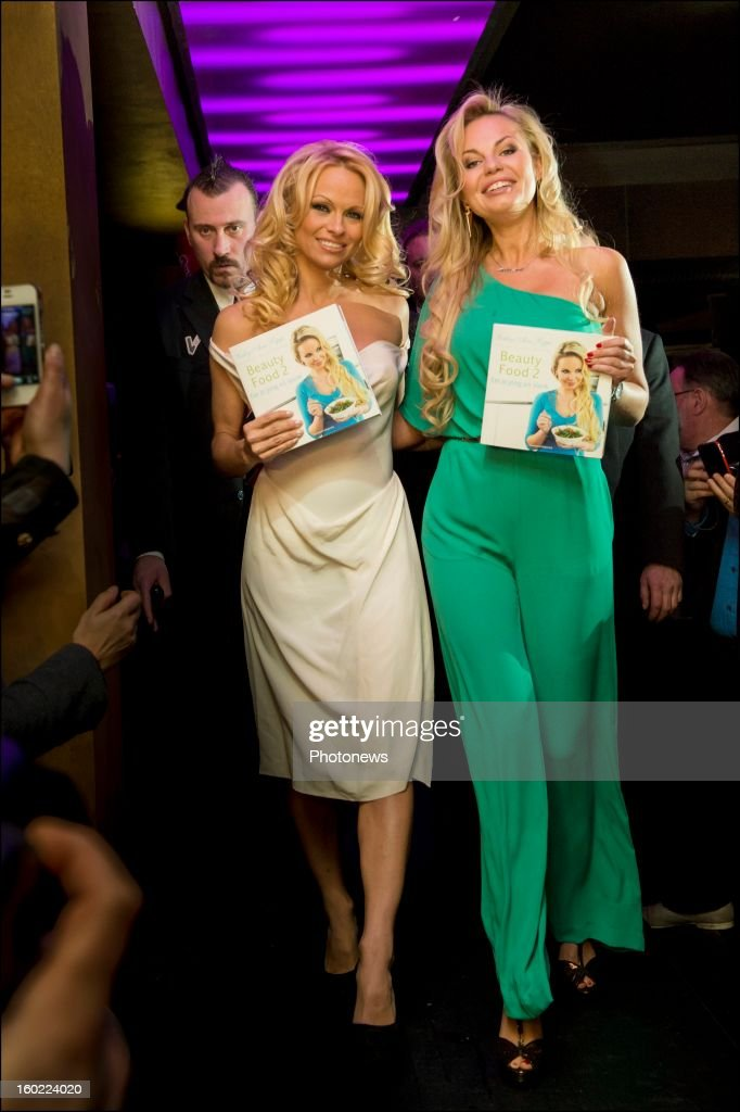 Actress <a gi-track='captionPersonalityLinkClicked' href=/galleries/search?phrase=Pamela+Anderson&family=editorial&specificpeople=171759 ng-click='$event.stopPropagation()'>Pamela Anderson</a> poses during her visit to Antwerp where she came to promote the book of her friend Belgian socialite Lesley-Anne Poppe 'Beauty Food'on January 22, 2013 in Antwerp, Belgium.