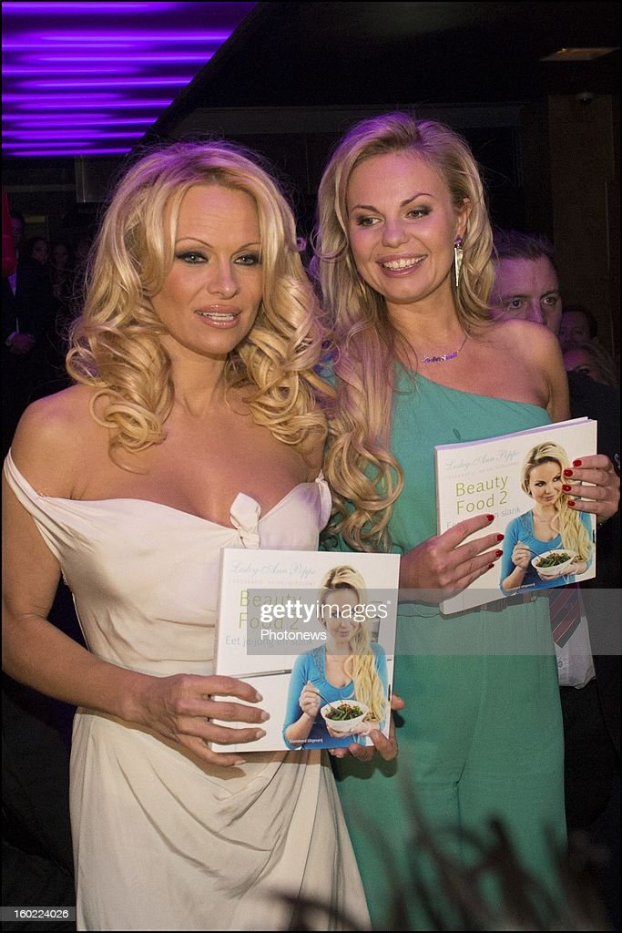 Actress Pamela Anderson poses during her visit to Antwerp where she came to promote the book of her friend Belgian socialite Lesley-Anne Poppe 'Beauty Food'on January 22, 2013 in Antwerp, Belgium.