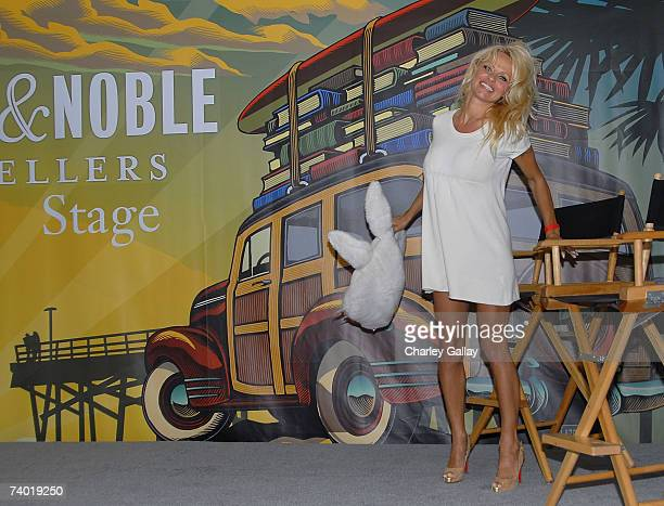 Actress Pamela Anderson poses onstage with a large costume rabbit head after introducing PETA Chief Dan Mathews at the 12th Annual LA Times Festival...