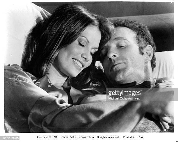 Actress Pamela Hensley and actor James Caan on set of the United Artist movie 'Rollerball' in 1975
