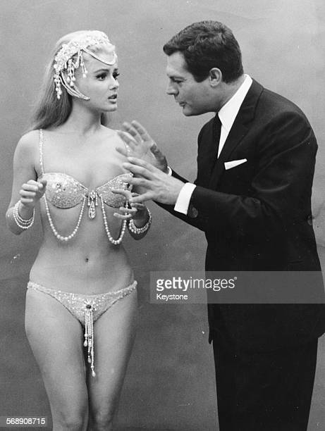 Actress Pamela Tiffin wearing a diamantine bikini and headdress and actor Marcello Mastroianni wearing a suit filming scenes for the film 'Paranoia'...