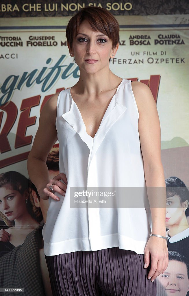 Actress Paola Minaccioni attends 'Magnifica Presenza' photocall at Adriano Cinema on March 12, 2012 in Rome, Italy.