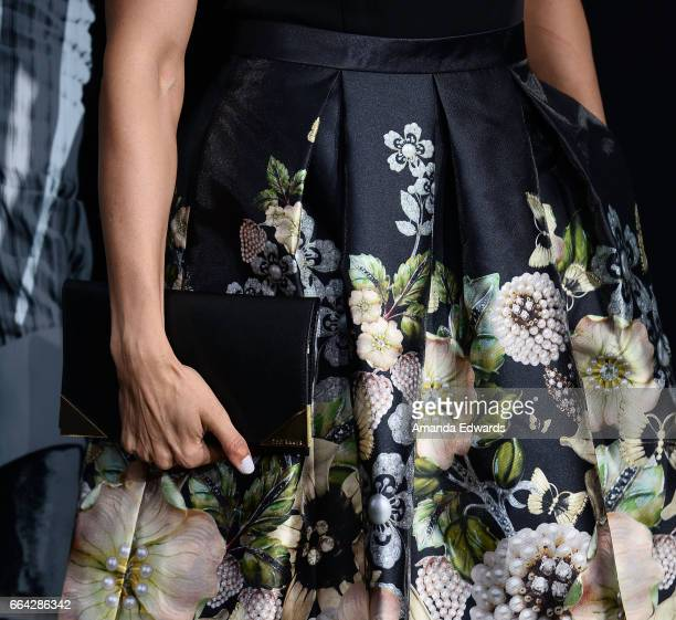 Actress Paola Nunez clutch and fashion detail arrives at the premiere of AMC's 'The Son' at ArcLight Hollywood on April 3 2017 in Hollywood California