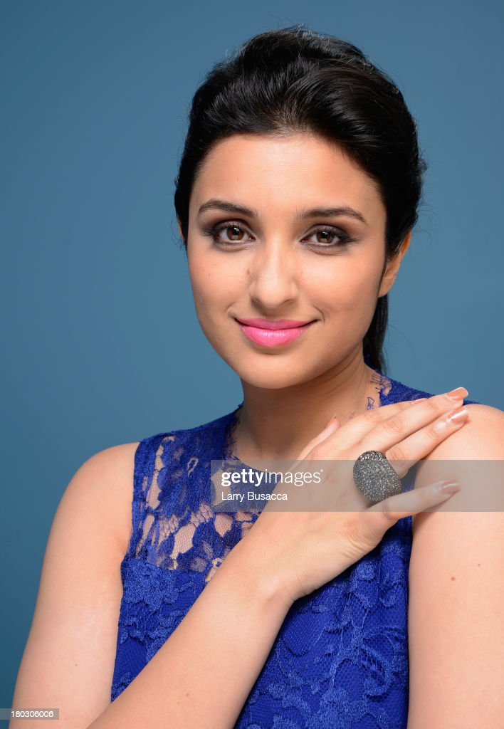 Actress Parineeti Chopra of 'Random Desi Romance' poses at the Guess Portrait Studio during 2013 Toronto International Film Festival on September 11, 2013 in Toronto, Canada.