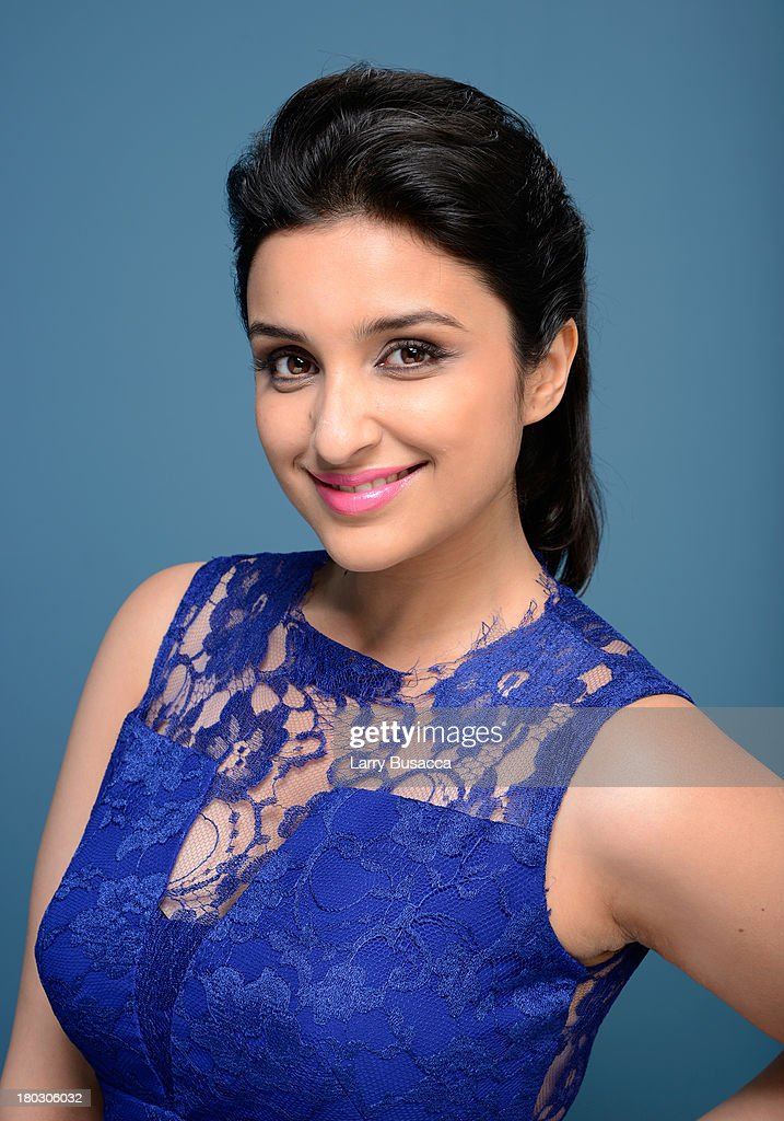 Actress <a gi-track='captionPersonalityLinkClicked' href=/galleries/search?phrase=Parineeti+Chopra&family=editorial&specificpeople=8923134 ng-click='$event.stopPropagation()'>Parineeti Chopra</a> of 'Random Desi Romance' poses at the Guess Portrait Studio during 2013 Toronto International Film Festival on September 11, 2013 in Toronto, Canada.
