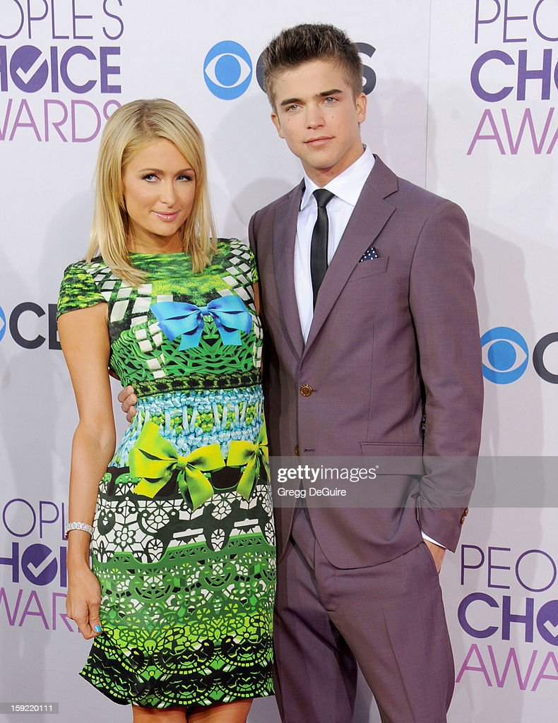 Actress <a gi-track='captionPersonalityLinkClicked' href=/galleries/search?phrase=Paris+Hilton&family=editorial&specificpeople=171761 ng-click='$event.stopPropagation()'>Paris Hilton</a> and model River Viiperi arrive at the 2013 People's Choice Awards at Nokia Theatre L.A. Live on January 9, 2013 in Los Angeles, California.