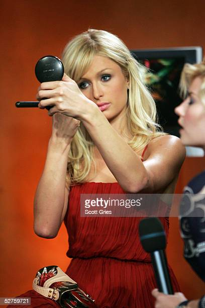 Actress Paris Hilton checks her makeup onstage during Fuse TV's Daily Download with the cast of 'House of Wax' at Fuse Studios on May 4 2005 in New...
