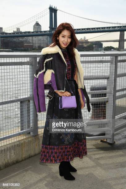 Actress Park Shinhye attends Coach Spring 2018 fashion show during New York Fashion Week at Basketball City Pier 36 South Street on September 12 2017...