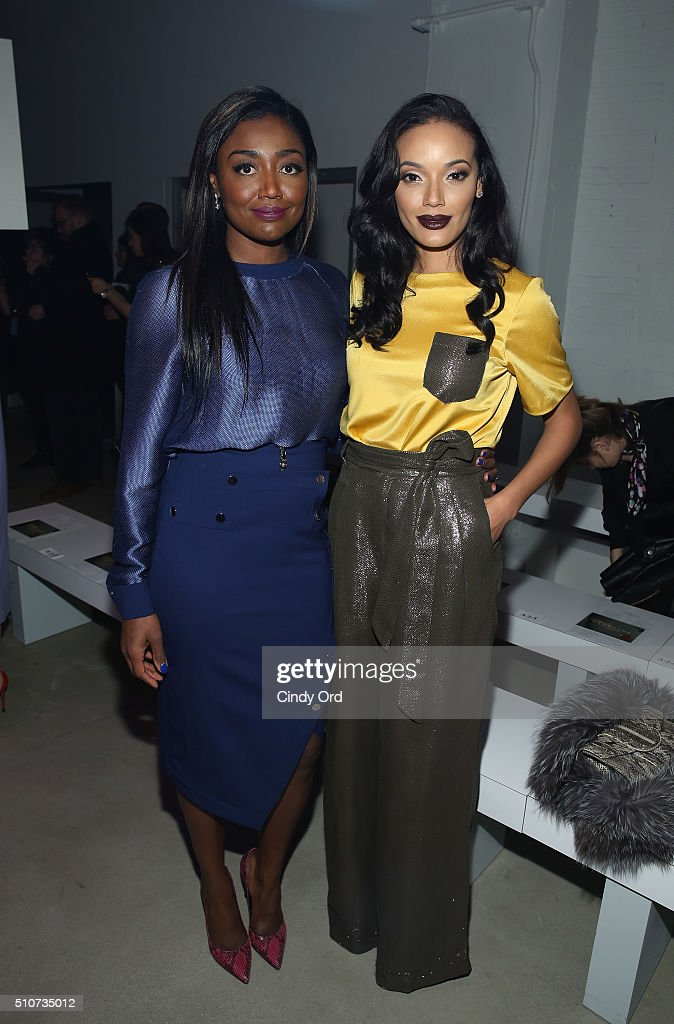Actress Patina Miller (L) and Selita Ebank attend the Georgine Fall 2016 fashion show during New York Fashion Week: The Shows at The Gallery, Skylight at Clarkson Sq on February 16, 2016 in New York City.