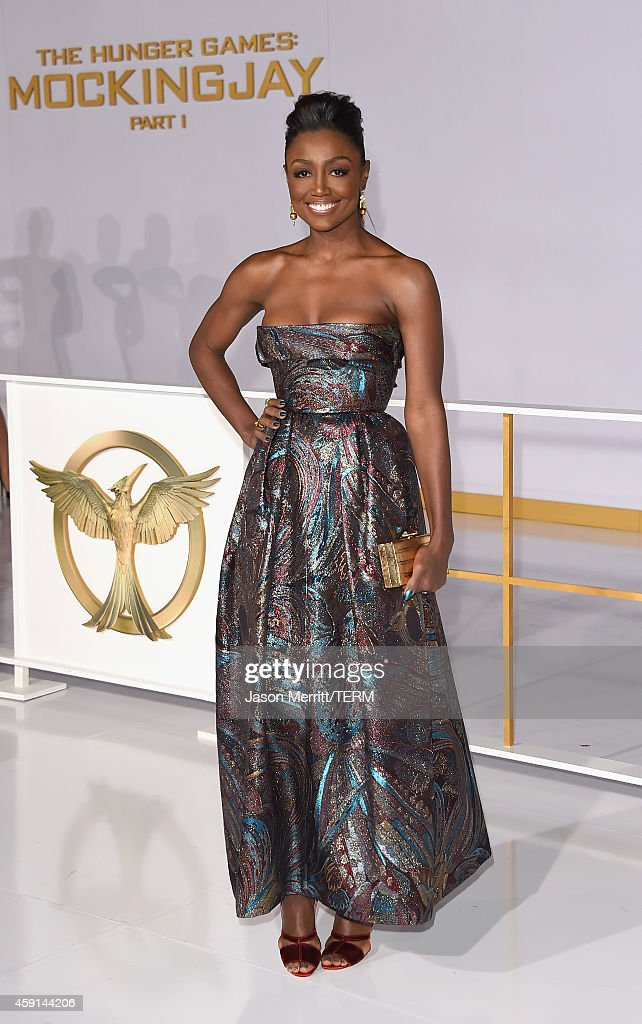 Actress Patina Miller attends the Premiere of Lionsgate's 'The Hunger Games Mockingjay Part 1' at Nokia Theatre LA Live on November 17 2014 in Los...