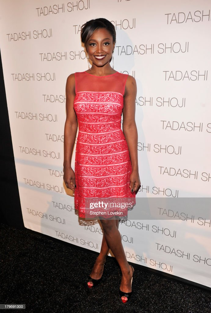 Actress <a gi-track='captionPersonalityLinkClicked' href=/galleries/search?phrase=Patina+Miller&family=editorial&specificpeople=5748190 ng-click='$event.stopPropagation()'>Patina Miller</a> prepares backstage at the Tadashi Shoji Spring 2014 fashion show during Mercedes-Benz Fashion Week at The Stage at Lincoln Center on September 5, 2013 in New York City.