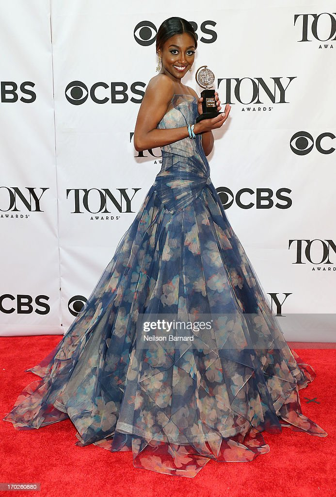 Actress <a gi-track='captionPersonalityLinkClicked' href=/galleries/search?phrase=Patina+Miller&family=editorial&specificpeople=5748190 ng-click='$event.stopPropagation()'>Patina Miller</a>, winner of the award for Best Performance by a Leading Actress in a Musical for 'Pippin' poses in The 67th Annual Tony Awards at Radio City Music Hall on June 9, 2013 in New York City.