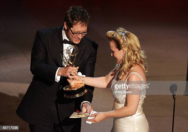 Actress Patricia Arquette accepts her award for Outstanding Actress in a Drama Series for 'Medium' onstage from actor James Spader at the 57th Annual...