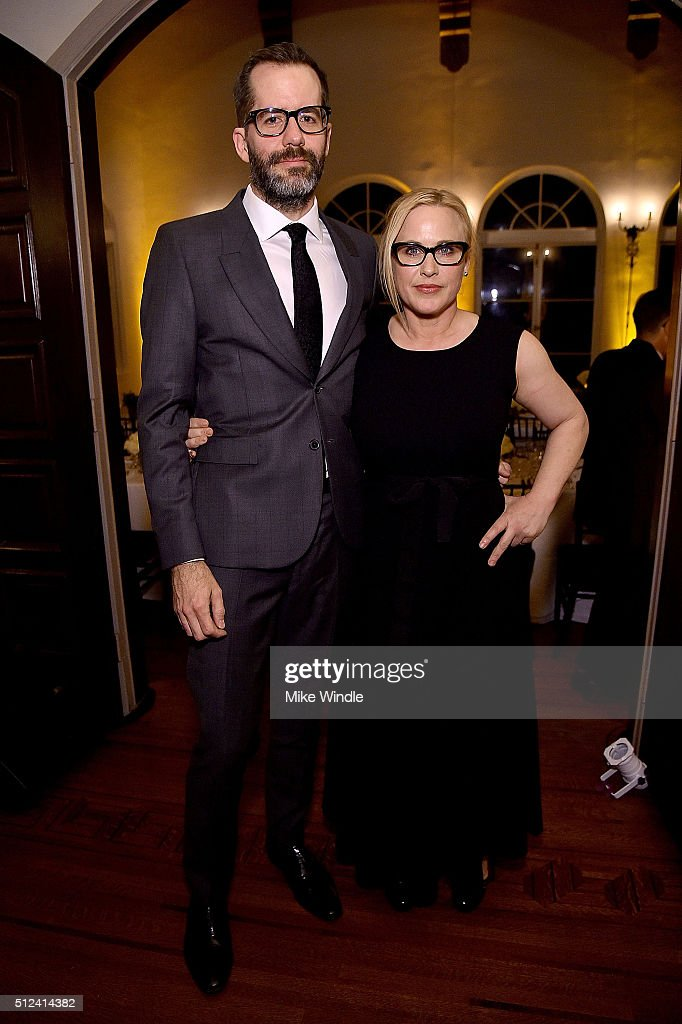 Actress Patricia Arquette (R) and artist Eric White attend The Dinner For Equality co-hosted by Patricia Arquette and Marc Benioff on February 25, 2016 in Beverly Hills, California.