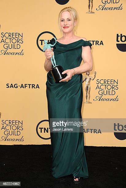 Actress Patricia Arquette poses in the press room at the 21st annual Screen Actors Guild Awards at The Shrine Auditorium on January 25 2015 in Los...
