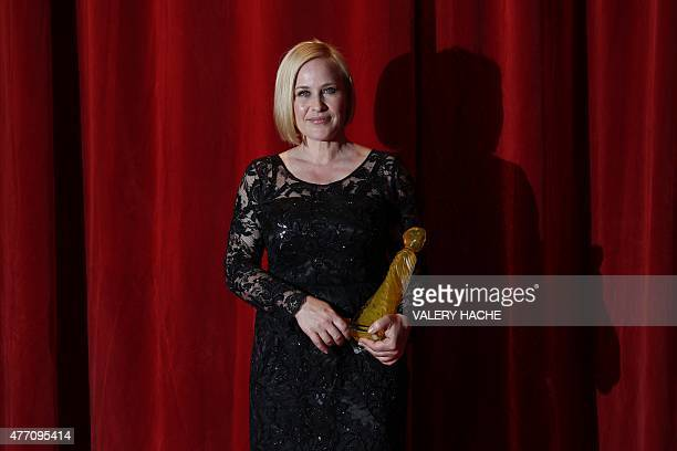 US Actress Patricia Arquette poses with her 'Nymphe de Crystal' award during the opening ceremony of the 55th MonteCarlo Television Festival on June...
