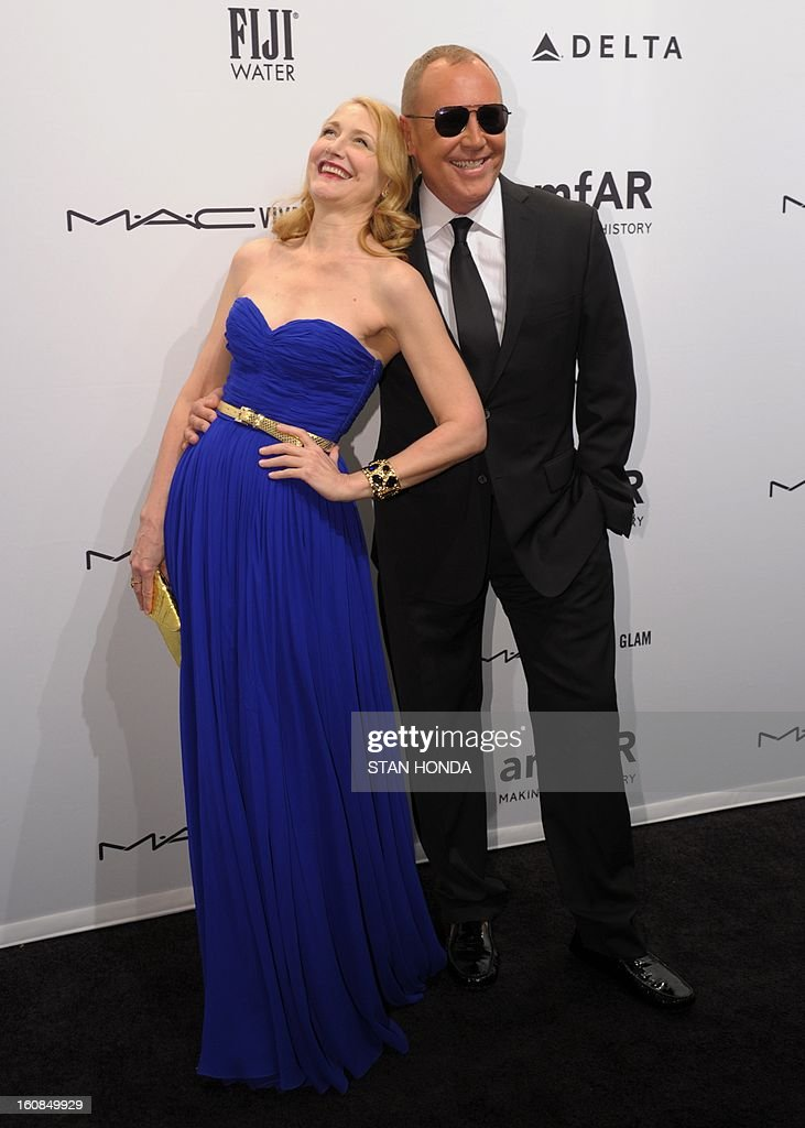 Actress Patricia Clarkson (L) and designer Michael Kors (R) at the amfAR (The Foundation for AIDS Research) gala that kicks off the Mercedes-Benz Fashion Week February 6, 2013 in New York. AFP PHOTO/Stan HONDA