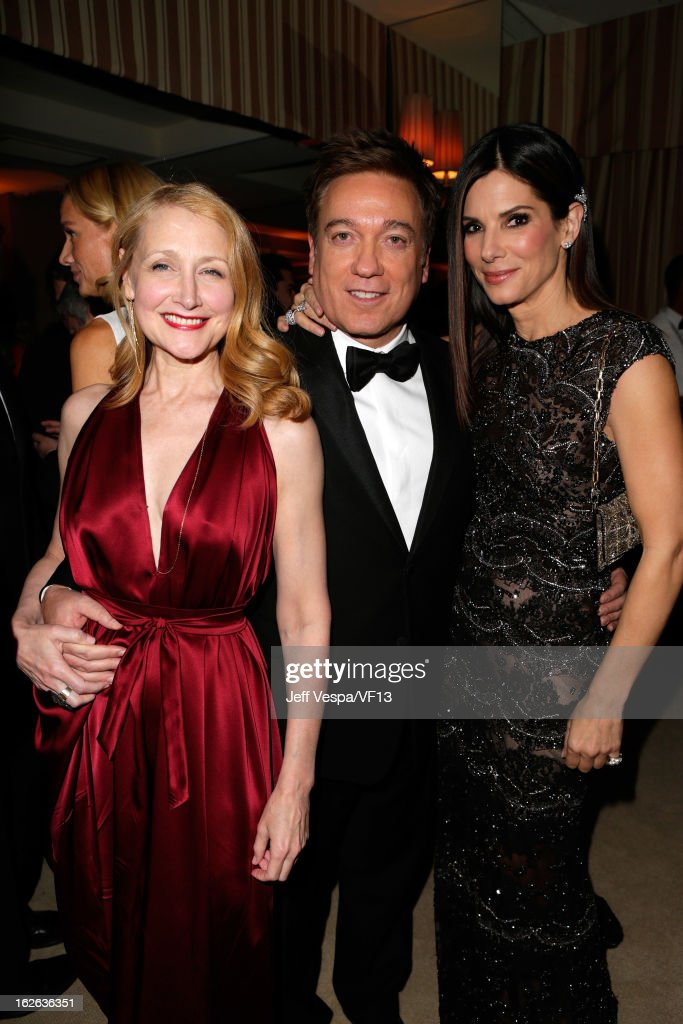 Actress Patricia Clarkson, CAA Kevin Huvane and actress Sandra Bullock attend the 2013 Vanity Fair Oscar Party hosted by Graydon Carter at Sunset Tower on February 24, 2013 in West Hollywood, California.