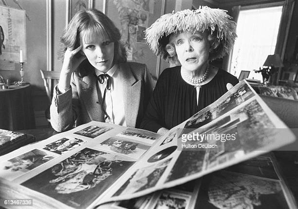 Actress Patricia Hodge and famous socialite Lady Diana Cooper look through photographs of the 1930's