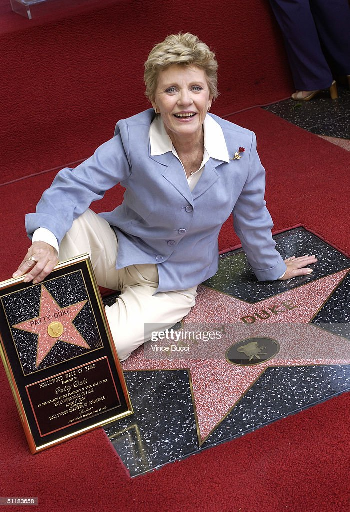 Actress <a gi-track='captionPersonalityLinkClicked' href=/galleries/search?phrase=Patty+Duke&family=editorial&specificpeople=93921 ng-click='$event.stopPropagation()'>Patty Duke</a> attends a ceremony honoring her with a star on the Hollywood Walk of Fame August 17, 2004 in Hollywood, California.