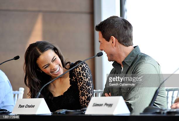 Actress Paula Patton and actor Tom Cruise laugh as they attend the 'Mission Impossible Ghost Protocol' Press Conference during the 8th Annual Dubai...