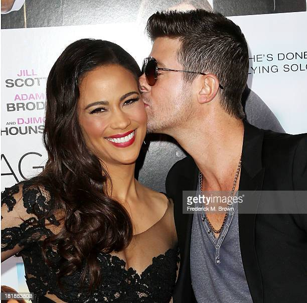 Actress Paula Patton and recording artist Robin Thicke attend the premiere of Fox Searchlight Pictures' 'Baggage Claim' at the Regal Cinemas LA Live...