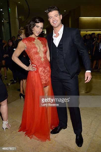 Actress Paula Patton and recording artist Robin Thicke attend the 56th annual GRAMMY Awards PreGRAMMY Gala and Salute to Industry Icons honoring...