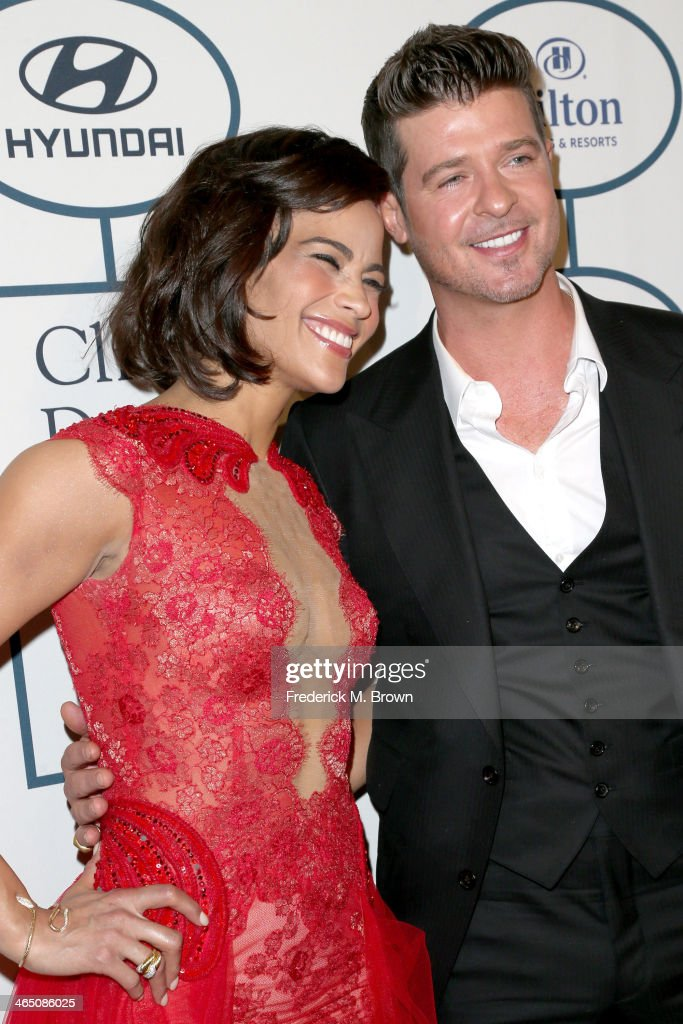 Actress Paula Patton (L) and recording artist Robin Thicke attend the 56th annual GRAMMY Awards Pre-GRAMMY Gala and Salute to Industry Icons honoring Lucian Grainge at The Beverly Hilton on January 25, 2014 in Beverly Hills, California.
