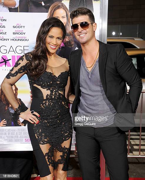 Actress Paula Patton and singer Robin Thicke arrive at the Los Angeles premiere of 'Baggage Claim' at Regal Cinemas LA Live on September 25 2013 in...